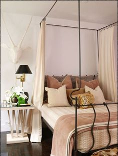 neutral palette, iron canopy bed