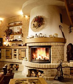 Round fireplace makes your home look like a hobbit hole!
