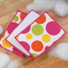 Microfiber Sponges feature a polka dot pattern on one side and a non-scratch scour side. They are safe for non-stick cookware. Made from Polyester. These sponges are great for cleaning any surface of your kitchen. Machine wash and tumble dry. A variety of colors to match most any decor.