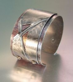 Cuff bracelet with applied fold formed sheet by Melody Armstrong via Ganoskin