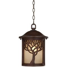 This hanging outdoor light is a wonderful accent for any home and perfect rustic or lodge type living spaces. Style # at Lamps Plus. Hanging Lantern Lights, Lantern Light Fixture, Outdoor Hanging Lanterns, Led String Lights, Light Fixtures, Ceiling Lights, Craftsman Outdoor Lighting, Tree Lamp, Amber Glass
