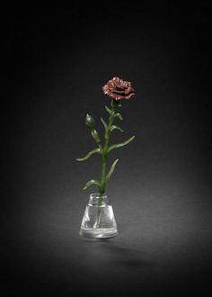 Produced by Faberge in the 1890s, and is thought to be from the workshop of Mikhail Perkhin. The flower is made from red jasper and inset with diamonds, attached to a delicate nephrite stem with leaves gracefully spreading from it. The complete flower rests in a rock crystal tapering vase, which is carved to imitate water.
