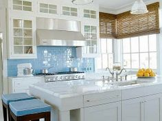 Kitchen with turqouise backsplash from Life in Rehab
