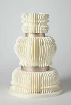 Brides: America's Prettiest Wedding Cakes | An Elegant Ivory Accordion Fold Cake | Cake by Charm City Cakes