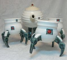 A small squad of the invading robot forces here to serve you tea (or coffee)!