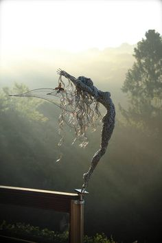 fantasy wire sculptures of fairies are by Robin Wight,