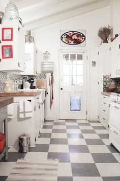 Grey & White Checker Floor, White Cabinets, Wood Countertop, Vintage Stove