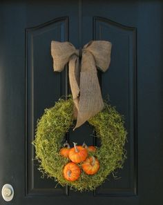 Moss and pumpkins with a burlap bow - so pretty