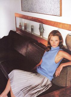 Sleeveless sweater + plated skirt on Kate Moss photographed by Mario Testino for Vogue, March 1998
