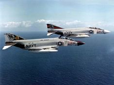 """F-4J Phantom II of Fighter Squadron VF-21 """"Free Lancers"""" and a F-4J of VF-154 """"Black Knights"""" in flight. Both squadrons were assigned to Carrier Air Wing 2 (CVW-2) aboard the aircraft carrier USS Ranger (CVA-61). Date circa 1970 Source U.S. Navy National Museum of Naval Aviation"""