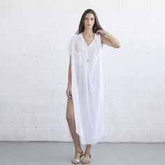 The Long Kaftan Dress was inspired by the traditional Islamic Kaftan robes. The dress is very light and elegant. Its made of 50% cotton and 50% rayon. It has buttons down the chest and one button on each side for closure. It is summery, loose and very comfortable to wear. The dress can work just as a top, it looks great with long jeans, leggings or shorts. Very fun to style. Be Creative!