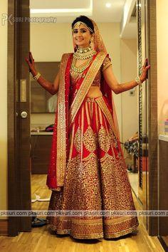 Red wedding lehenga by Sabyasachi styled with polki studded necklace set and…