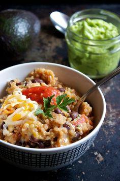 Mexican Quinoa Dish: quinoa, vegetable broth, black beans, tomatoes, corn, jalapeños, cilantro, lime, salsa, sour cream, cheese, tortilla chips, guacamole #vegetarian