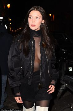 Daring to bare: Bella, 20, stole the attention away from gal pal Kendall by donning a completely sheer black top, going braless for the occasion
