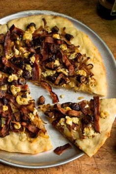 NYT Cooking: Here is a recipe for pizza that calls to mind — at least this mind — the joys of car travel through southeastern France, where pizzas such as this are available at all the imaginary cafes in small towns near the Italian border. It certainly tastes as if it comes from that region and, if you close your eyes as you eat it, you can almost imagine yourself halfwa...