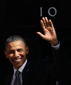 Barack Obama waves to the media as he arrives at 10 Downing Street   Photograph: Adrian Dennis/AFP/Getty Images