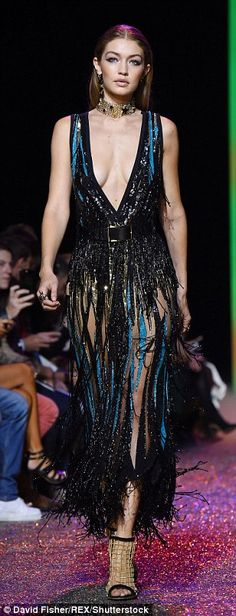 Model moment: Gigi Hadid was in her element as she stormed down the runway at Elie Saab's SS17 catwalk presentation at PFW on Saturday