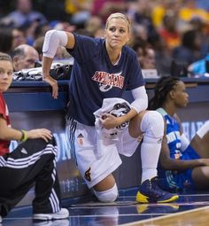 Indiana Fever's Katie Douglas (23) waits at the score's bench to re-enter the game during the first half of an WNBA basketball game at Banke...