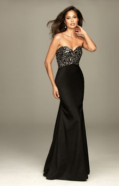 Sassy but Classy!! Evenings by Allure A416 is how you do 'animal print chic' and is an absolute Genealogy favorite! This beautiful modern gown has a body hugging fit to the skirt with a slight flare at the bottom for movement while you're dancing the night away. The bust is a classic sweetheart neckline with a little surprise twist in the back