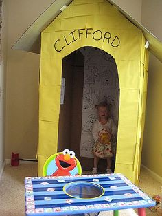 I love,love, love this idea!  Put coloring sheets on the wall of Clifford's house.  I am thinking about making the house wider too and having a reading area stocked with Clifford books.