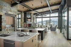 Raise the roofline to even rather than sloping. Slope-Side Living in Montana Modern Rustic Homes, Rustic Home Interiors, Rustic Home Design, Modern Interior Design, Rustic Style, Mountain Home Interiors, Modern Lodge, Modern Mountain Home, Mountain Living