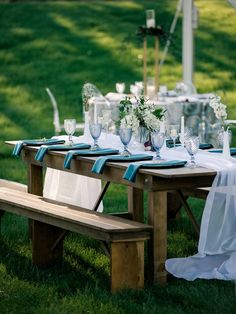 Our White Voile Table Veil drapes and gathers lovely on this rustic wooden table and bench set paired with Ocean Blue Plush Velvet Napkins. Rustic Wooden Table, Wooden Tables, Extra Long Table Runners, Clear Tent, Table And Bench Set, Wedding Decorations, Table Decorations, Table Linens, Plush
