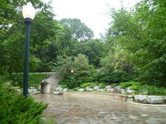 The Elmwood Park neighborhood in Omaha, Neb. is a historically significant area that was developed in the late 19th and early 20th century. Elmwood Park is the home of a natural spring located in the southeast corner of the park; the grotto has been around since the early 20th century. The area is now used commonly as a wedding venue site and a backdrop for portraits. In earlier years, the grotto served as a place where people would gather water to drink or bath. - Rachael Lopez (No. 1)