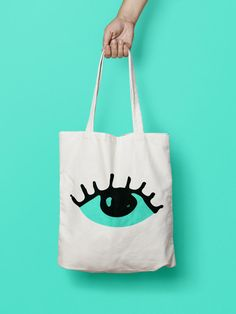 "Eye Tote Bag - Canvas Tote Bag - Printed Tote Bag - Market Bag - Cotton Tote Bag - Large Canvas Tote - Funny Quote Bag - Fish Tote Bag Totes are that universal product that everyone needs and uses. A book bag, a grocery bag, or just somewhere to throw in all of those little everyday items. 100% Bull Denim Woven Cotton construction Dimensions: 14 3/8"" x 14"" (36.5cm x 35.6cm) Dual handles Fabric weight 11.0 oz/yd² (373 g/m²) Superior screen printing results A cute, all-purpose natural c"