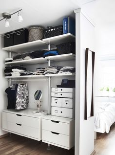 Open storage saves space and makes it easy to organise and find your clothes. 'An open set-up meant we could fit a dressing area in a separate part of the room to the sleeping area