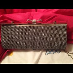 Silver clutch Silver sparkly clutch with mesh overlay. Rhinestone bow clasp with chain shoulder strap. Used once at prom. Bags Clutches & Wristlets