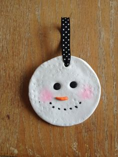 Simple snowman ornament that you can make with kids. Sculpey Premo Polymer Clay