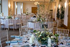 The Wilde Bunch December 2017 at Coombe Lodge. A room shot to show the effectiveness of the taller designs and the warmth added by the twinkling lights. Perfect on a cold winter night. See loads more ideas on the Coombe Lodge page on our website. Lodge Wedding, Wedding Venues, Wedding Decorations, Table Decorations, Winter Night, Twinkle Lights, Innovation Design, Lodges, Wedding Season