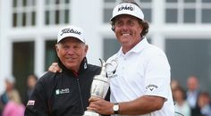 Phil Mickelson poses with Butch Harmon after winning the 2013 Open Championship at Muirfield. Phil Mickelson, Butches, Rain Jacket, Windbreaker, Poses, Golf, Image, Raincoat, Figure Poses