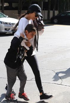 "Keep up with Kourtney in a  Yeezy Calabasas sweatshirt  Click ""Visit"" to buy #DailyMail"