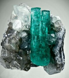 Vivid green Emerald on sparkly Calcite matrix. Next to it is a twinned Calcite. From Coscuez Mine, Boyaca Dept., via stone finder Colombia Minerals And Gemstones, Rocks And Minerals, We Will Rock You, Mineral Stone, Rocks And Gems, Gemstone Colors, Emerald Gemstone, Stones And Crystals, Gem Stones