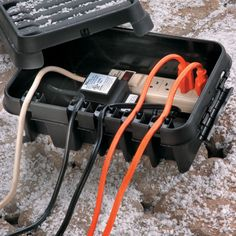 Keep your Christmas decoration extension cords and other electrical cords dry and organized with this handy weatherproof box.