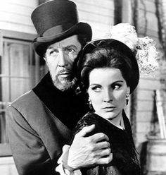 Vincent Price and Debra Paget in THE HAUNTED PALACE (1964).