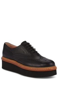 Tod's Leather Oxford Creepers are a modern take on the classic Oxfords. Handcrafted in Italy from semi-glossy leather, these lace-up shoes feature wingtip perforations on upper and a thick leather welt and oversized, extra-light rubber outsole. This style is finished with Tod's hot-stamped logo and the iconic embossed rubber pebbles.