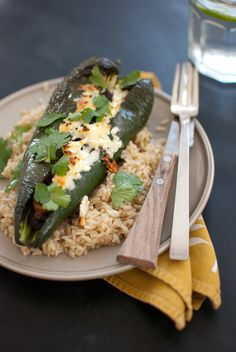 Beer bean-stuffed poblano peppers! YUMMERS! (540 calories/serving including 1 cup long grain brown rice per recipe) *Tried, tested, easy and delicious!* Next time I'll leave seeds in and maybe add some hot sauce on top because I felt like I was missing the heat!