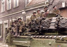"""US troops of the 3rd Battalion 513 PIR, 17th Airborne Division share a ride on a Churchill Mk IV tank """"Bandit"""" of 'C"""" Squadron, Nº11 Troop, 4th Coldstream Guards, 6th Guards Tank Brigade. Appelhülsen a few miles from Munster (final target) on 1st April 1945."""