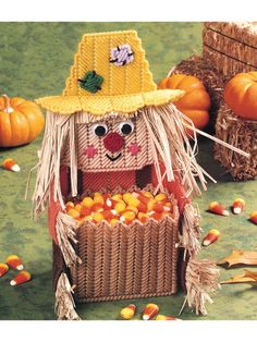 Plastic Canvas - How cute is this Scarecrow Candy Keeper, made using 7-count plastic canvas and worsted-weight or plastic canvas yarn? Also needed are 2 15mm wiggle eyes and small amount of natural raffia. Size: 3' x 5 5/8' x 9 1/2'T, not including legs. - #YP00646