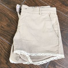 Tan Linen Shorts Ambiance Apparel tan linen shorts with white crochet on bottom - perfect condition!  perfect for the heat! Size medium.  72% rayon Ambiance Apparel Shorts Cargos