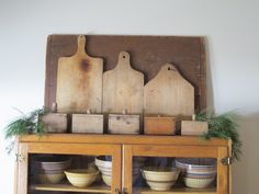 Early bread boards with butter molds and all natural Christmas greens.