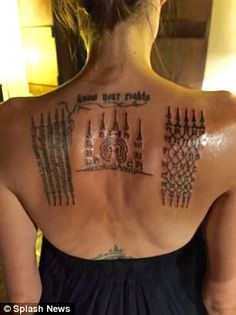 The Hollywood actress - who was in the country directing her Netflix movie First They Killed My Father at the time - had flown the tattoo artist from Bangkok to work on the symbolic inkings.
