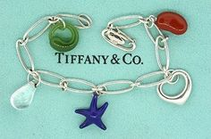 TIFFANY & CO.925 STERLING SILVER PERETTI 5 CHARM BRACELET. Get the lowest price on TIFFANY & CO.925 STERLING SILVER PERETTI 5 CHARM BRACELET and other fabulous designer clothing and accessories! Shop Tradesy now