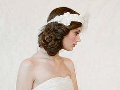 Gorgeous side bun paired with a bridal headband