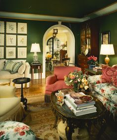 In a word- gorgeous!  Love the green walls, pink, floral and cream furniture, arched doorway, secretary...........just everything!