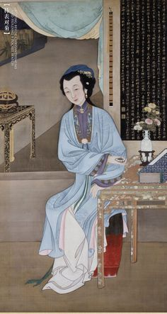Qing Dynasty. 清,北京故宫藏。《十二美人图》持表对菊 |  仕女手持精美的珐琅表坐于书案旁。桌上瓶中插有菊花,点明了时值八月时节。菊花清高典雅,是秋季重要的观赏花卉,被赋予坚贞、益寿等含义,同时又以其素净优雅的自然美而成为女性的头饰或居室的点缀品。背景墙面上悬挂着明代董其昌的诗句。不远处几案上的西洋天文仪器与女子手中的珐琅表表明西洋物件已渐为宫中时尚。