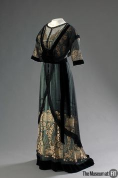 "Madame Percy | c. 1910 In the early 20th century, cultivated women regarded pastels and muted shades as refined and ""lady-like,"" while bright colors seemed ""vulgar."" Tastes would soon change, and after about 1910, vivid colors increasingly came into fashion. This aqua silk, however, is still muted by a layer of black net and ivory lace."