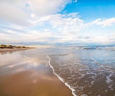 This tiny Outer Banks town is a true getaway: With few commercial distractions, your family can while away the days boogie-boarding, shell-collecting, and kite-flying. Take a beach stroll; you'll probably catch a glimpse of wild horses. Image Credit: carolinadesigns.com